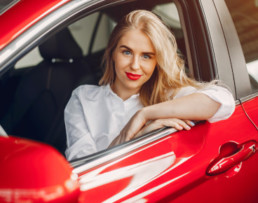 woman in red car